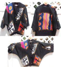 1980s printed jacket / oversized colorful 80s VINTAGE batwing sleeve JACKET / AFRICAN art tribal jacket / Abstract tribal jacket. $32.00, via Etsy.