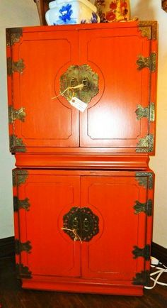 Asian style nightstands painted in  CHALK PAINT® Barcelona Orange w/ a touch of Emperor's Silk, and antiqued.