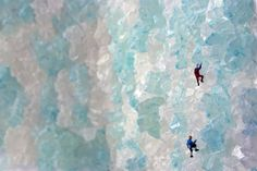 people climbing ice