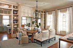 Dining room with pale aqua rug, and creamy beige walls - Southern Living House Plan #1426, Captain's Watch - (Coastal Living 2007 Idea House http://www.coastalliving.com/homes/idea-houses/2007-captains-quarters-idea-house-00414000076687/ ) #beachy
