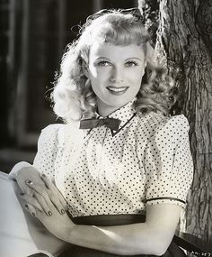 British actress Anna Neagle looking girl-next-door gorgeous in a sweetly lovely polka dot blouse and cute curls.