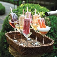 Bridal Shower:   Love this Champagne idea of serving it in wine glasses with colorful Popsicle s.