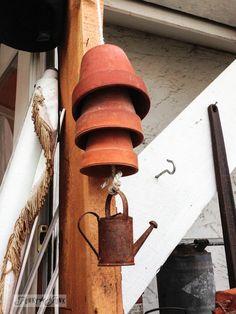 Funky clay pot garden wind chime via http://www.funkyjunkinteriors.net/