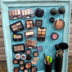 OMG... I need to make this!! add magnets to the back of makeup with hot glue. Also, used spray painted pill bottles for brush holders. Another idea, use magnetic locker baskets to hold other items.