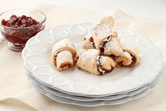 Rugelach cookies.  The dough is cream cheese based and the filling is a combination of raspberry jam, cocoa powder, cinnamon, and chopped walnuts.