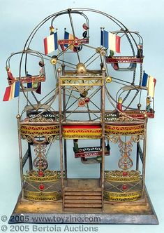 What a lovey piece! Antique German toy ferris wheel.  Learn about your collectibles, antiques, valuables, and vintage items from licensed appraisers, auctioneers, and experts at BlueVault. Visit: http://www.bluevaultsecure.com/roadshow-events.php