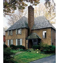 Popular in the 1920s, the French Revival style is know for its steeply-pitched hip roof (without front-facing gable), flared eaves, and an exterior in brick, stucco, or stone. |  Photo: Colin McGuire | thisoldhouse.com