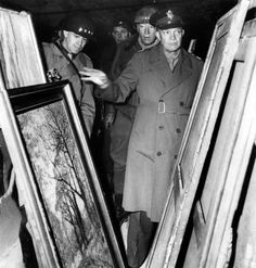 Generals Omar Bradley, General George Patton and General Dwight Eisenhower inspecting art that was  stolen by the Nazis.