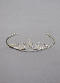 "This adorable childs tiara is beautifully embellished with faux pearls and sparkling rhinestones.   Sure to make any child feel like a princess.  Measures 1 1/4"" high. Imported.  Available in stores in Silver.  Available in Gold in stores only."