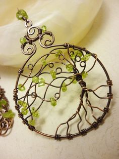 Peridot and antique brass pendant OOAK wire wrapped jewelry.