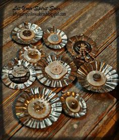 A little rusty around the edges is what I loved about these tart tins. I flattened them and layered mother of pearl buttons and other fun treasures to complete the design.