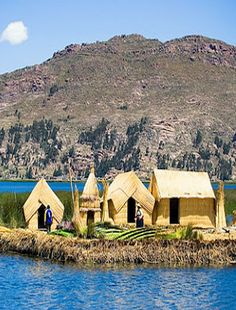 The Uros people live in small floating islands in the bay of Puno on the shores of Lake Titicaca, in south-eastern Peru. The 60 islands are home to about 1,000 people & are made out of the reeds that grow in abundance in the shallow waters - Photo: Mattia Cabitza