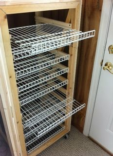 soap curing cabinet, with movable racks, screening on the doors and on wheels.