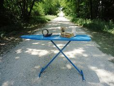 """Retro Blue Ironing Board  .."""".yeah, I'm just out here in the road, ironing some stuff....would you just run me that big orange extension cord down here."""""""