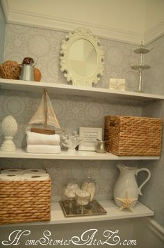 Decorated bathroom shelves and bathroom reveal.