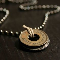 Coolest thing ever...they make jewelry out of vintage tokens...I want this...maybe a CTA.