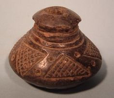 """Colombia Clay whorl, 1-1/8"""" tall by 1-3/4"""" diameter. Colombia (Quimbaya), 1000 – 1500 A.D."""