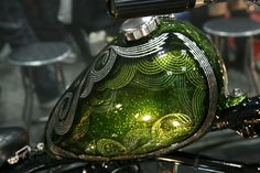 green & silver metal flake pinstriping paintjob on peanut tank