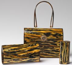 1950's tiger clutch, lunchbox purse, and lipstick holder, by Wilardy