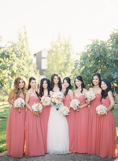 Bridesmaids -- by Monique Lhuillier   See the wedding on SMP: http://www.StyleMePretty.com/2014/03/10/peach-inspired-farm-wedding-at-carneros-inn/ Jen Huang Photography