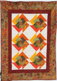 """Autumn Swirl Quilt Pattern by Julia Gray Creations at KayeWood.com. This JULIA GRAY ORIGINAL PATTERN features 15"""" blocks in a 48"""" x 63"""" large throw. Easy to follow directions lets you make this original block to create the look of swirling movement. http://www.kayewood.com/item/Autumn_Swirl_Quilt_Pattern/3352 $11.00"""