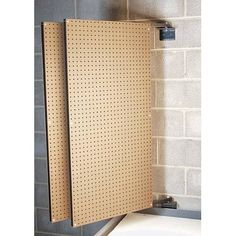 How about wall mounted swinging pegboard panels?  Now that might be an interesting solution for lots of sewing notions...