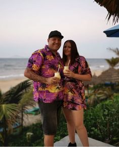 Gorgeous Couples Clothing - Matching tropical style for fun holiday vibes. Wearing Purple Sunset in Mens Hawaiian Shirt and Ladies Kaftan/Poncho.  #pinacolada #caughtintherain #amazing #views #islandstyleclothing #matchymatchy #hoian #drink #beachhangs #beach