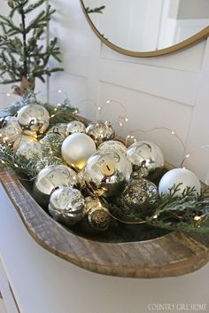Hobby Lobby dough bowl filled with mercury glass ornaments and twinkle lights. #christmasdecor