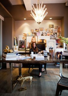 jennifer fisher's glam /cool office with lucite fixture, wood/metal desk and huge pinboard wall