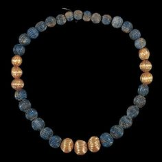 Jewelry from The Royal Tombs of Ur.  Gold and lapis lazuli necklace.  The Sumerians, more than any other people in the world, loved lapis lazuli. For them, it represented fabulous wealth, literally and as well as figuratively. It is not  indigenous to Sumer, and was mined in faraway Afghanistan. Because it had to be imported over vast distances, it was very expensive.