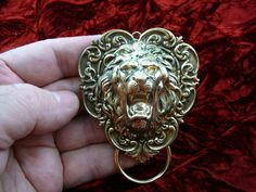 Lion lion's head Victorian repro brass Eyeglass pin pendant ID badge holder E-676. $30.99, via Etsy.