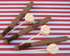 For Father's Day or Baseball theme party! Baseball - chocolate covered pretzel bats & marshmallow pop baseballs