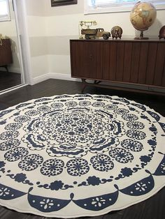 DIY Rug from a table cloth and maybe some felt or carpet cusion underneath. This could be sprayed with a varnish of some sort to be durable. Great idea!