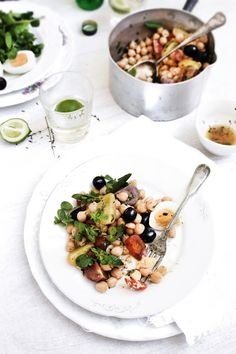 chickpea salad with herb marinates tomatOes watercress black olives and hard boiled eggs