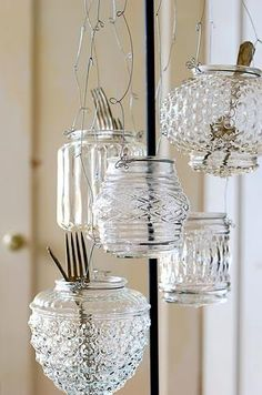 Wrap the lips of old globe light fixtures with wire and use them to hold candles or for organization - so much more interesting then ball jars!  The globes are pretty inexpensive at Home Depot - also check out Salvation Army and Habitat for Humanity Restore stores.  Great sources for funky stuff!