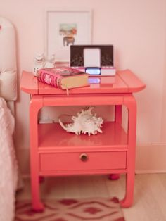 Lacquered coral pink night stand against soft pink blush walls is just gorgeous!