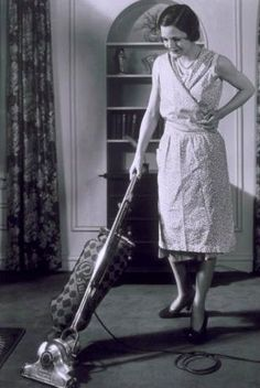 A wrapper for vacuuming. wearing heels while house cleaning in the 40's and 50's.