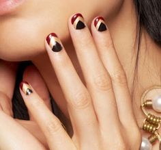 black and gold and red and chevron nails