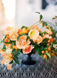 Lovely. #wedding #events #centerpiece #flowers #orange #linen #black #white