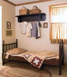Hanging Around: Display a grouping of antique children's clothing on a painted peg rack; hang the garments on primitive wood hangers for mor...