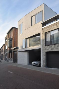 Belgian studio Areal Architecten inserted this brick and concrete townhouse into a residential streetscape in Mechelen near Antwerp