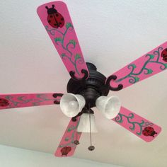 Took the fan blades off, spray painted pink and added simple paintings to brighten up a kids room :)