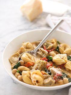 Tortellini Soup with Artichokes and Garbanzo Beans #recipe on foodiecrush.com #tortellini #soup #chickpeas #artichoke