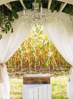 Wedding arbor and glam chandelier for ceremony ideas. Venue: Maplehurst Farms ---> http://www.weddingchicks.com/2014/05/20/italian-infused-rustic-chic-wedding/