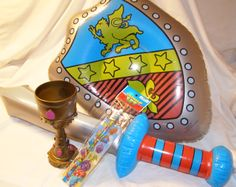 This is what you get in our Wrapped Knight Favor Pack.  Inflate sword  shield, Goblet, Sticker set.  #knight #knightpartyfavor