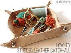 Heh, we purchased a similar product at a Renaissance Festival a few years back... Except ours has snaps instead of studs.  Here's how to make 'em on your own:  Studded Leather Catch-All