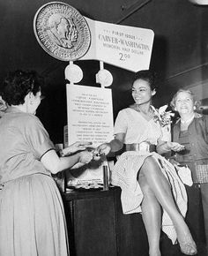 "The unforgettable Eartha Kitt selling the new Carver-Washington half-dollars - for $2 each - at Macy's in New York City in August 1952. The promotion was a special program to aid the Booker T. Washington Birthplace Memorial. The coins were embossed with the slogan, ""Freedom and Opportunity For All - Americanism."" Photo: Bettman/Corbis."