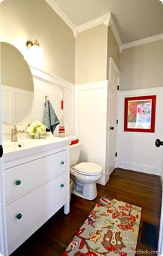 white bathroom with red and blue