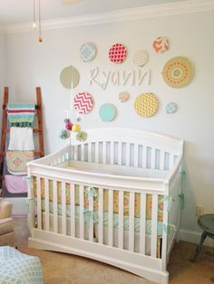Love the embroidery hoop wall in this sweet nursery! #nursery #nurserydecor