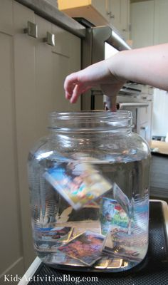 Kids love creating gifts for family and friends. Let them help you make this fun photo memory jar. It just takes a jar, photos, glitter, glycerin and water! So easy!